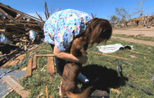 Tornado victim reunites with dog during interview