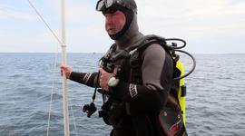 Michel L'Hour, director of France's Department of Underwater Archaeological Research, prepares to dive to what explorers believe may be the site of the Griffin in northern Lake Michigan.
