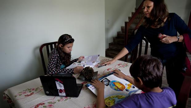 Adela Cavalcante talking to her children in Iraja, Brazil