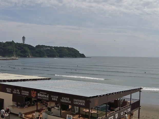 Windsurfers enjoy the early summer waves in the Japanese beach resort of Enoshima