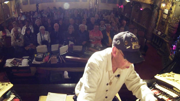 Fred Hermes works on his hobby in front of a live audience.