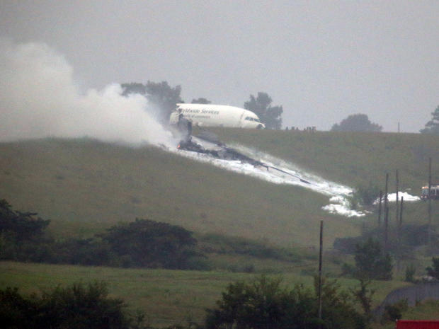 A UPS cargo plane lies on a hill at Birmingham-Shuttlesworth International Airport after crashing on approach Aug. 14, 2013, in Birmingham, Ala.
