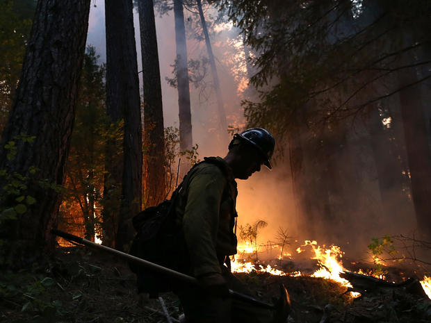 A firefighter from the Colorado-based Long Canyon Fire Department monitors a back fire while battling the Rim Fire Aug. 22, 2013, in Groveland, Calif., outside of Yosemite National Park.