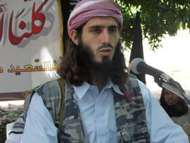 American-born Islamist militant Omar Hammami addresses a press conference of the militant group al-Shabab at a farm in southern Mogadishu's Afgoye district in Somalia May 11, 2011.