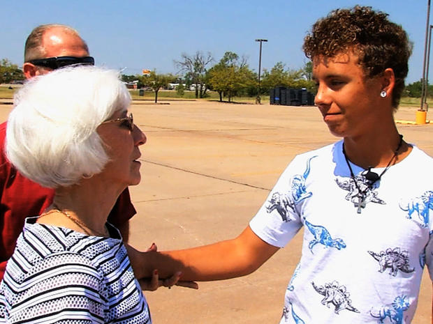 After an Okla. woman was robbed as she mourned the loss of her husband, the mugger's son knew he had to make up for his father's crime.