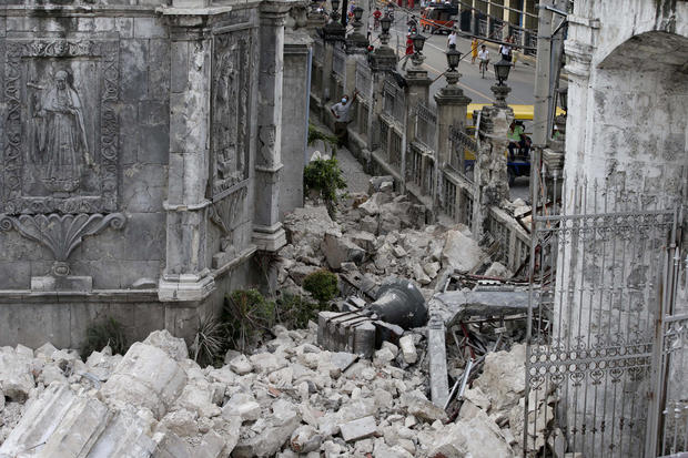 The bell of Basilica of the Holy Child lies amid the rubble following a 7.2-magnitude earthquake that hit Cebu city in central Philippines and toppled the bell tower of the Philippines' oldest church Tuesday, Oct. 15, 2013.