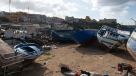 "A stretch of beach known as the ""boat cemetery"" is littered with the wreckage of vessels that made it to the island."