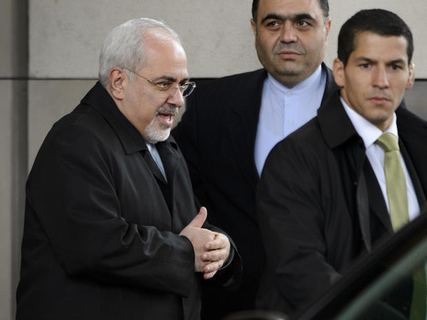 Iranian Foreign Minister Mohammad Javad Zarif leaves his hotel before the start of closed-door nuclear talks in Geneva