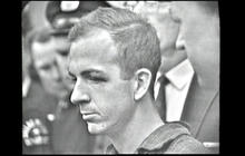 Lee Harvey Oswald charged with assassinating JFK