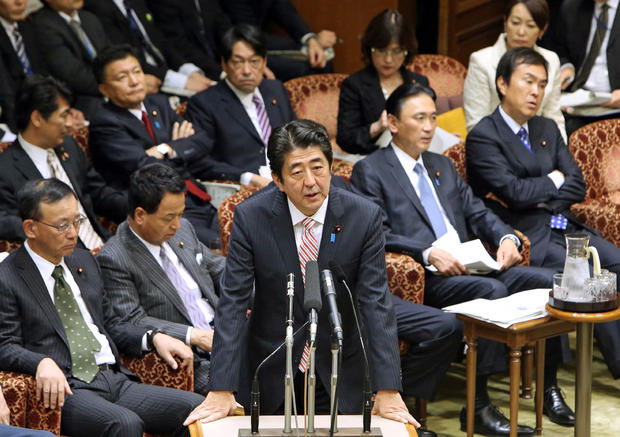 Japanese Prime Minister Shinzo Abe (C) answers a question during the Upper House's audit committee session at the National Diet in Tokyo