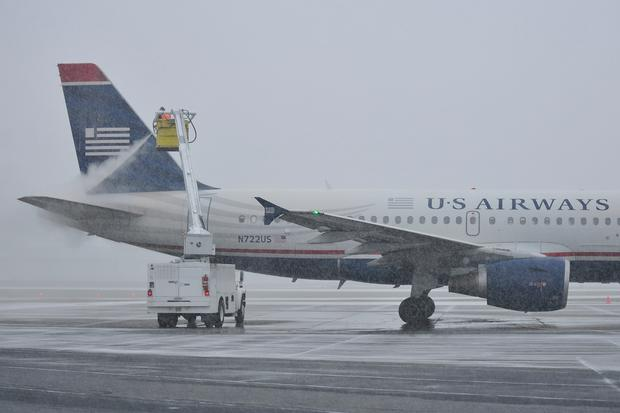 A worker at Lehigh Valley International Airport works on deicing and anti-icing an aircraft