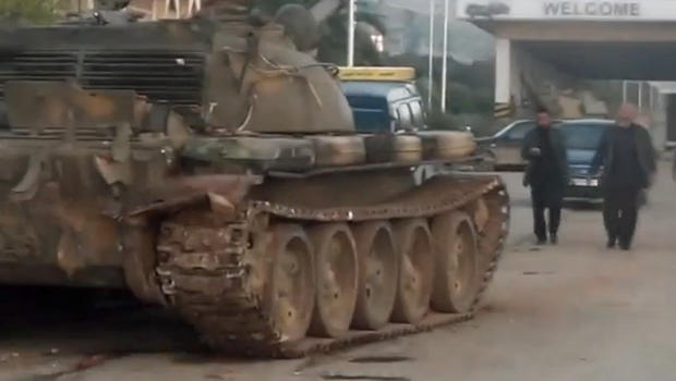 A Syrian military tank, commandeered by rebels loyal to the Western-backed opposition Supreme Military Council, is seen in front of the Bab al-Hawa border crossing with Turkey