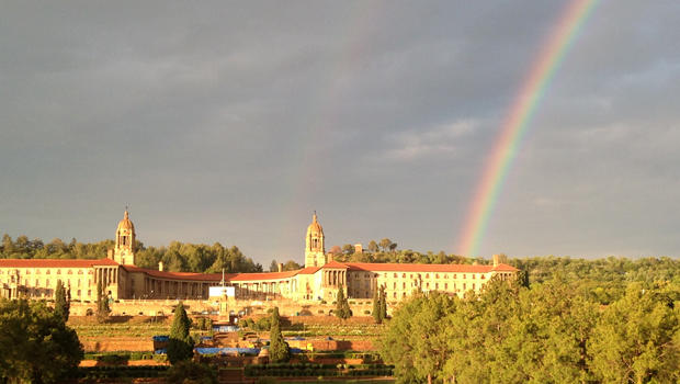 A rainbow is seen over the Union Buildings in Pretoria, South Africa, where former South African President Nelson Mandela's body lied in state for a second day Dec. 12, 2013.