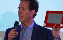 "Santorum shakes ""Etch A Sketch,"" mocks Romney"