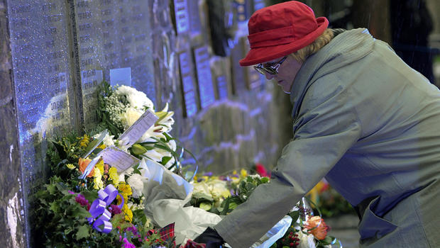 Families, relatives and dignitaries gather to pay their respects at the memorial service in Dryfesdale cemetery to commemorate the 25th anniversary of the bombing of Pan Am flight 103 in Lockerbie, Scotland, Dec. 21, 2013.