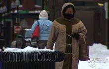 Boston digs out from snowstorm amid bitter temperatures