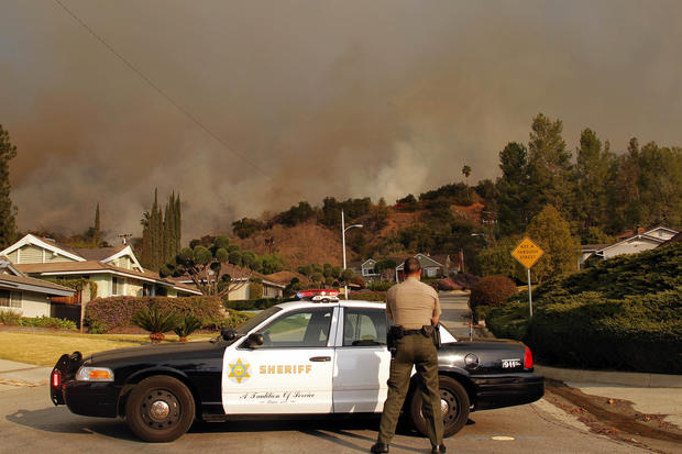 Wildfires burn through California