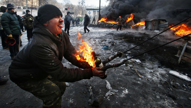 Protesters use a large slingshot to hurl a Molotov cocktail at police in central Kiev, Ukraine, Jan. 23, 2014.