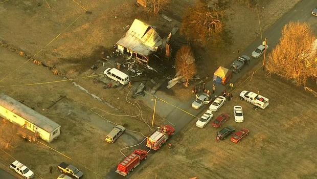 2014年1月30日,在格林维尔附近,可以看到致命的房屋火灾现场。