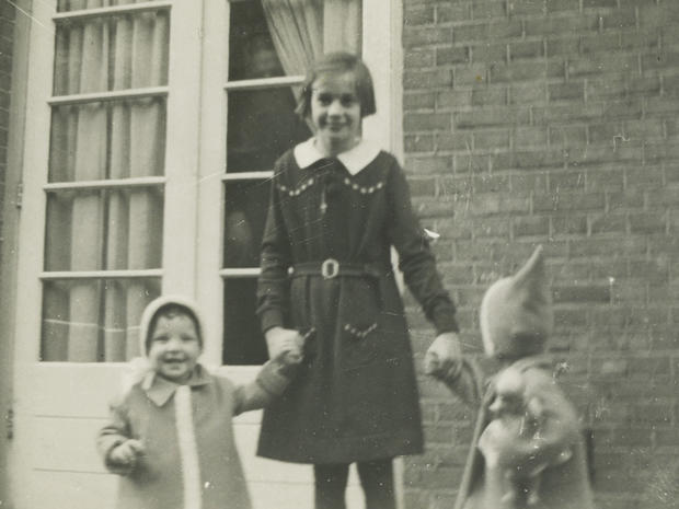 Toosje Kupers, centre, poses with two girls in Amsterdam