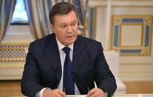 Ukraine's president flees Kiev, wanted for mass murder