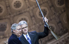 McConnell hits the CPAC stage, rifle in hand