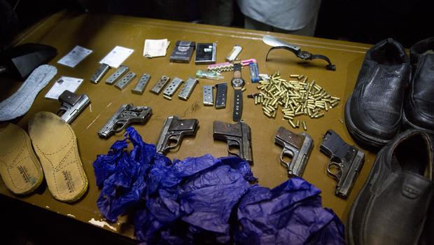 Afghanistan's intelligence service displays some of the weapons and belongings of attackers on the Serena hotel, during a press conference at the Interior ministry in Kabul