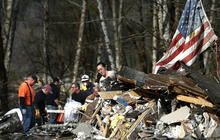 Rescuers search quicksand-like ground for Wash. mudslide victims