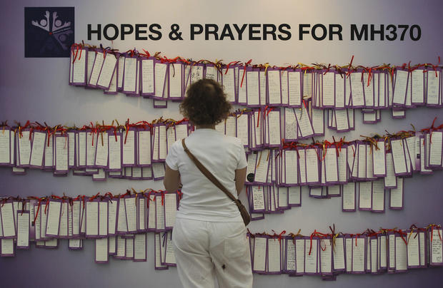 Flight 370 families grieve and protest