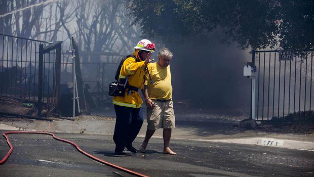 californiasandiegowildfiremanledaway.jpg