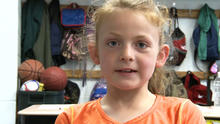 Abby Porter, 8, is seen in an interview with CBS affiliate KOAM-TV after taking the steering wheel when her mother fell unconscious in the driver's seat May 14, 2014.