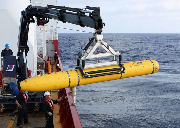 Crew aboard Australian Defence Vessel Ocean Shield moving U.S. Navy's Bluefin-21 autonomous underwater vehicle into position for deployment in southern Indian Ocean to look for missing Malaysia Airlines Flight 370 on April 14, 2014
