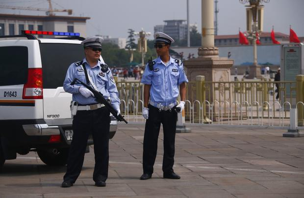 Armed police stand guard at Tiananmen Square in Beijing