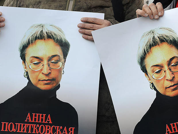Russian human rights activists attend a rally in honor of slain Russian journalist Anna Politkovskaya in Moscow