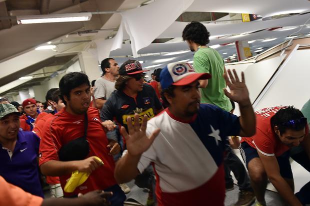 Fans storm stadium in Brazil
