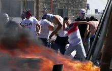 Israel prepares for retaliation, as Palestinians mourn murdered teen