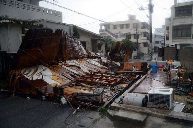 A wooden house collapsed during strong winds in Naha on Japan's southern island of Okinawa