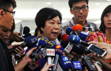Jean Shen, director of Taiwan's Civil Aeronautics Administration, speaks to reporters at the Sungshan airport in Taipei July 23, 2014.