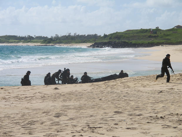 Japanese soldiers on a reconnaissance team come ashore at Kaneohe Bay, Hawaii, during amphibious landing practice July 29, 2014.
