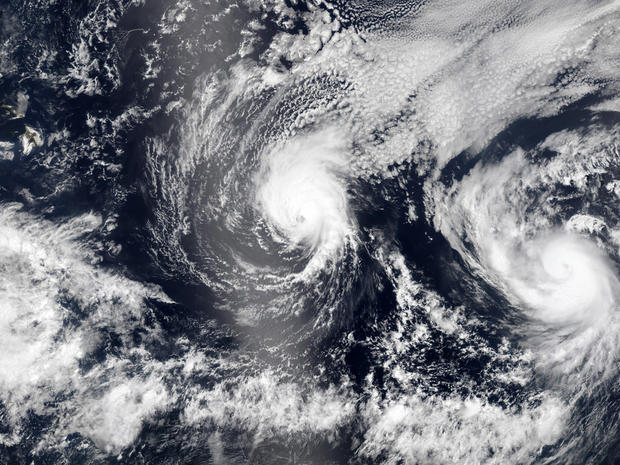 Hurricane Iselle and Hurricane Julio, right, are pictured en route to Hawaii, upper left, Aug. 5, 2014, in this NASA handout satellite image.
