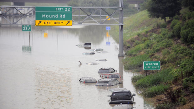 Cars are stranded along a flooded stretch of I-696 at the Warren, Mich., city limits Aug. 12, 2014.