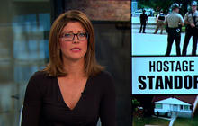 Four held hostage in Chicago suburb