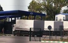 Russian convoy crosses into Ukraine