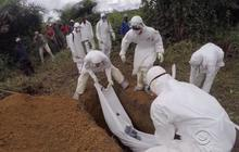 In burying the Ebola dead, some Liberians defy cremation order