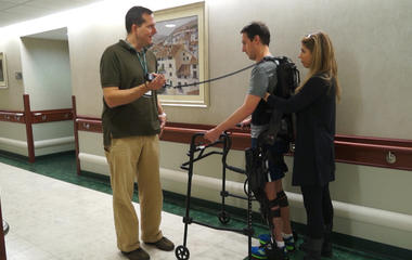 Exoskeleton robotics help a young stroke survivor get back on his feet