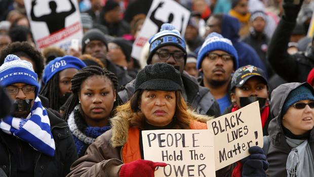 2014年12月13日,华盛顿民权活动家Rev. Al Sharpton领导的警察暴力活动引发全民正义游行的开始。