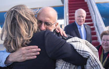 """I'm free"": Alan Gross returns to U.S. after five years in Cuban prison"