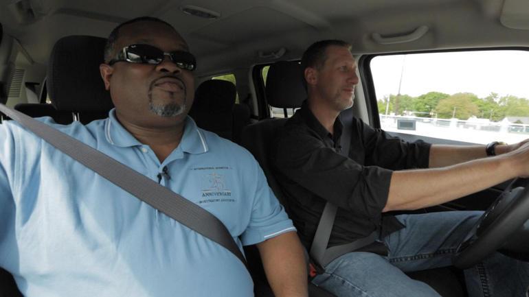 Agents Marlon Buggs, left, and Wayne Simock hit the road