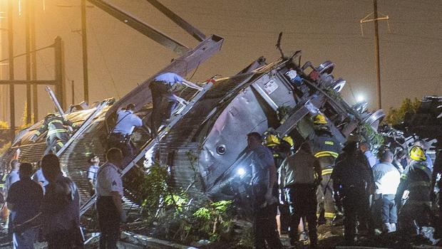 Rescue workers search for victims in the wreckage of a derailed Amtrak train in Philadelphia