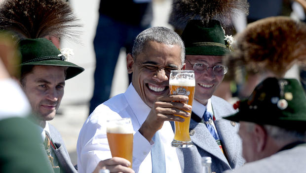 Slugging beer and sausages, Obama celebrates Germany - CBS News
